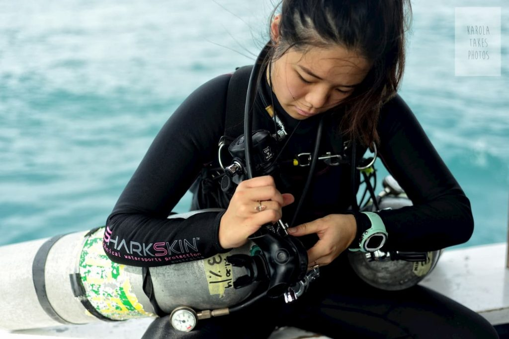 Sidemount Diver gearing up for a dive